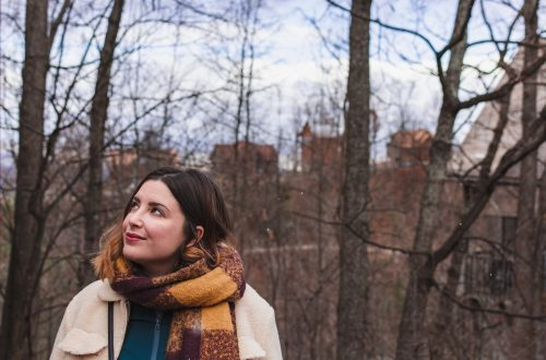 shallow focus photo of woman wearing brown scarf